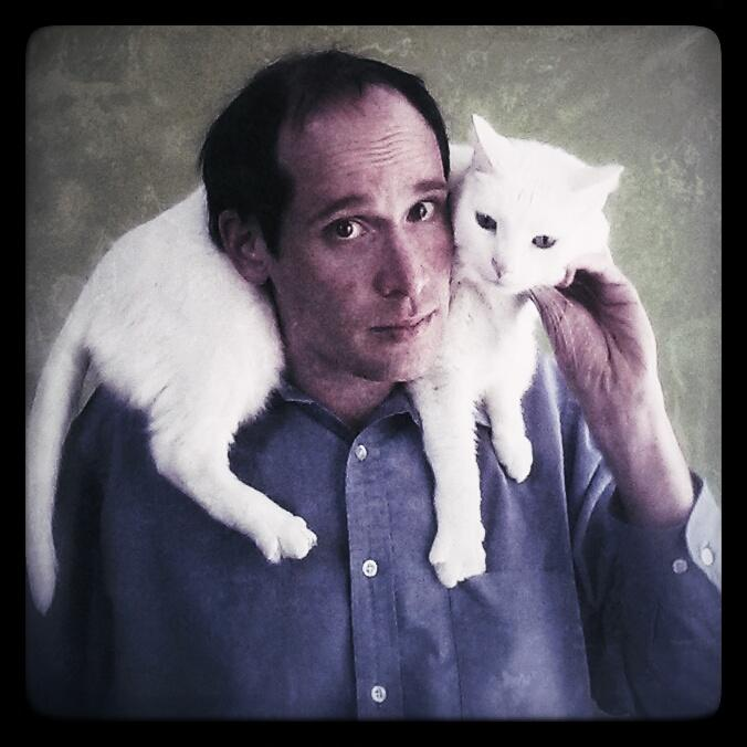 WYPR Morning Announcer Nathan Sterner strikes a pose with one of his five cats Inanna (aka 'Nanners).