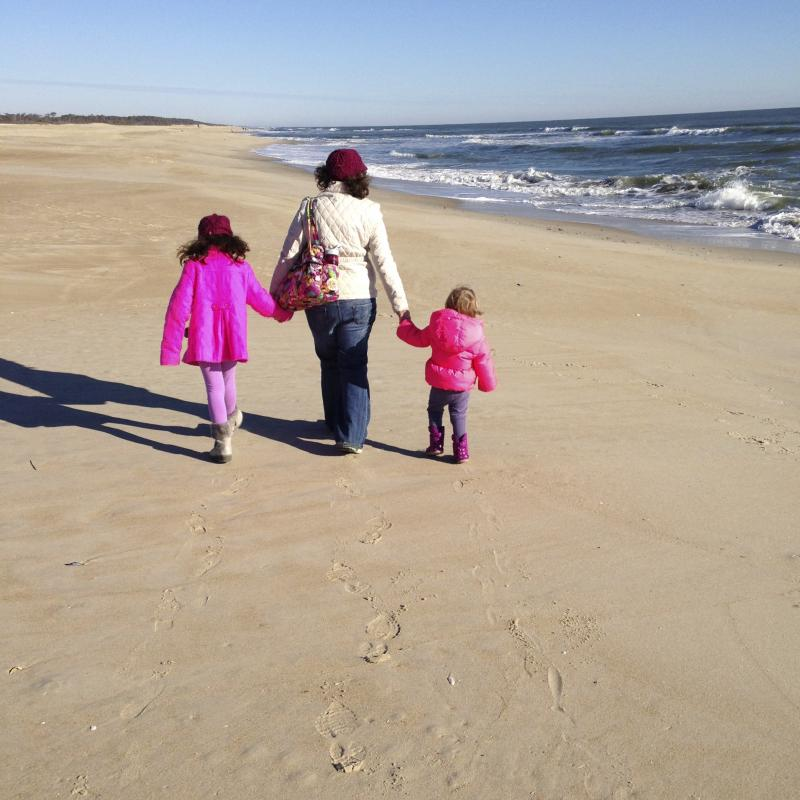 The Chesapeake Bay Journal's Rona Kobell enjoys a walk in the sunshine at Chincoteage Island with her daughters.