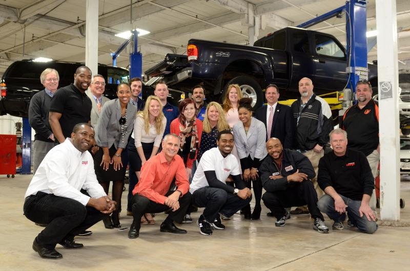Vehicles for Change staffers with a group of car recipients, all of whom received cars during th The Vehicles for Change staff at their shop on Washington Boulevard in Baltimore.