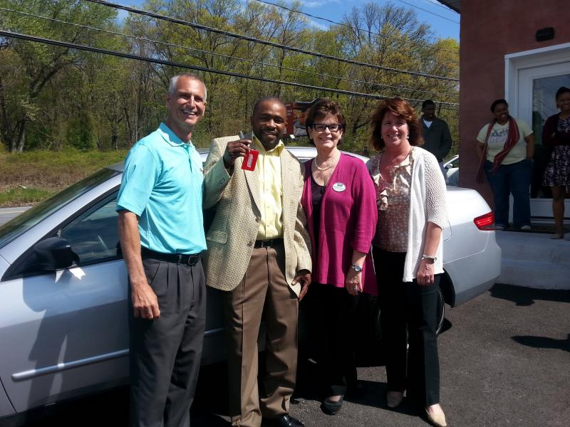 After finding full-time work as a detailer at Diamond Detailer, Edward Ray (second from left) was eligible to receive a car through the Vehicles for Change program. He paid $750 for the vehicle. The car makes it easier for Ray to travel to work.