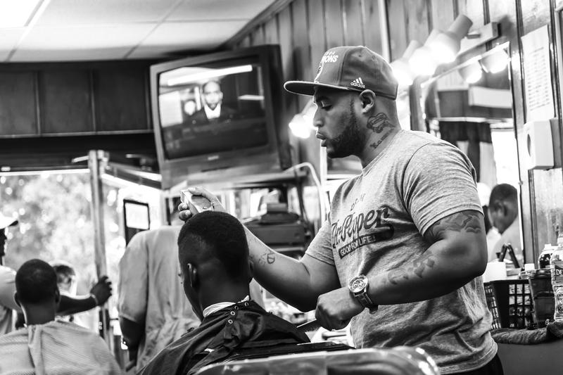 """I've been incarcerated twice. This barbering thing has helped me focus on the positive."" Marcus Carter, 419 E Patapsco Avenue"