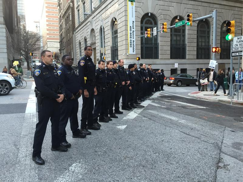 Baltimore City police block a street near the city courthouse after a mistrial was declared in the trial of Officer William Porter