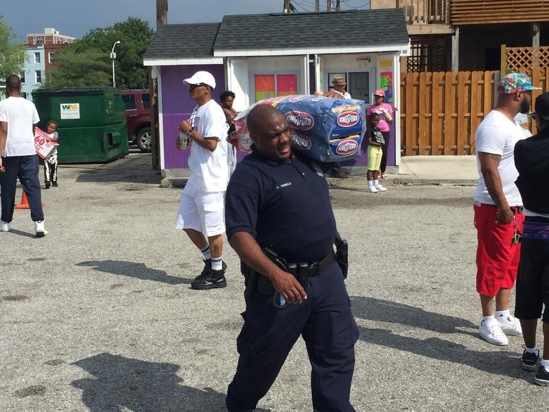 Scenes from Lor Scoots's community repast in West Baltimore.