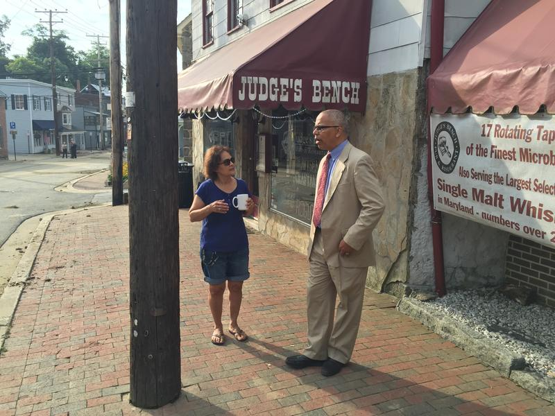 Maryland Lt. Governor Boyd Rutherford (right) speaking to Jane Johnson about floods that devastated historic Ellicott City.