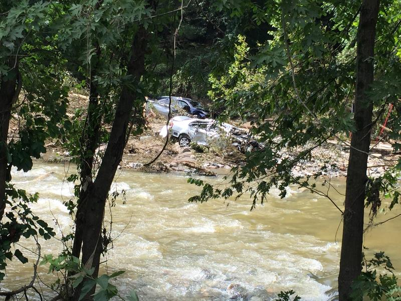 About 20 vechicles remain in the Patapsco River after being washed downstream from Ellicott City.  Many of the vehicles are totaled.