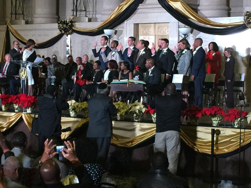Mayor Catherine Pugh administering the oath of office to members of the 72nd Baltimore City Council.  The new council is described by observers as younger and more progressve.