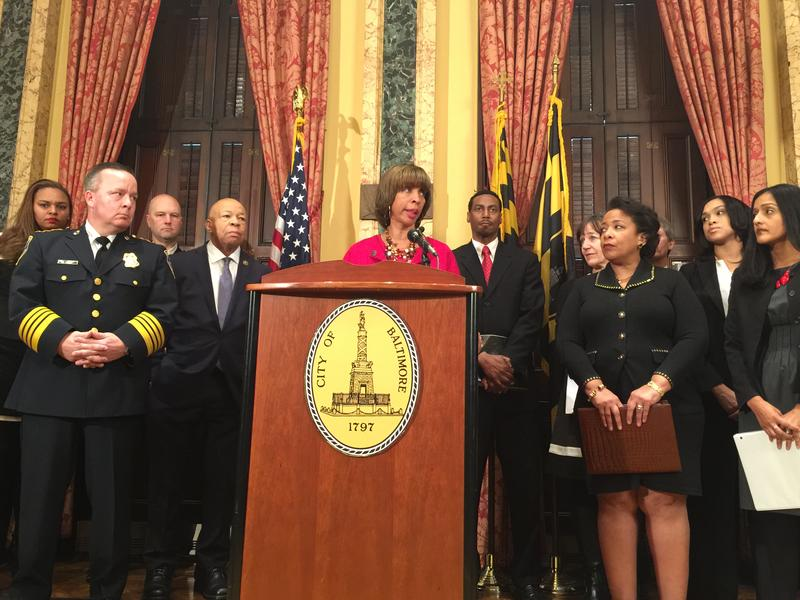 Baltimore Mayor Catherine Pugh commenting on a consent decree agreed upon between the city and the Justice Department.  Pugh is joined by (from left) Police Commissioner Kevin Davis and U.S. Attorney General Loretta Lynch among other officials.