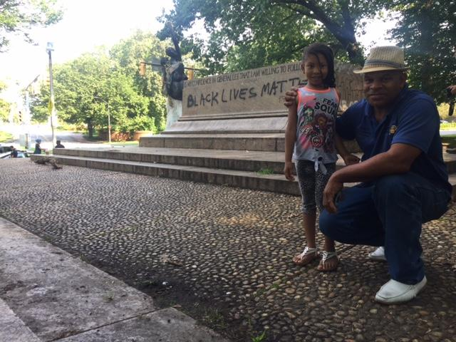 Larry Wallace and his daughter, seven-year-old daughter MacKenzie Wallace, at the base of what was the Lee-Jackson monument