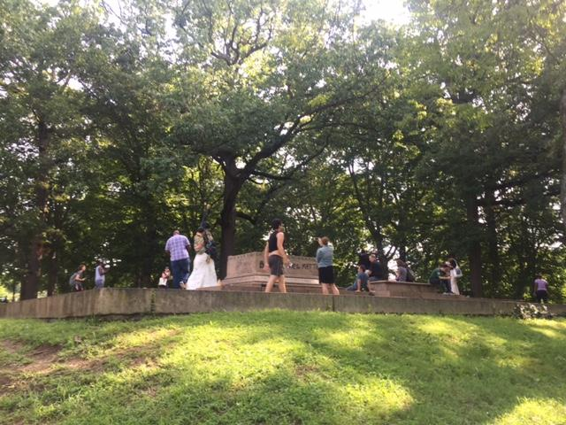 People gather in Wyman Park Dell to celebrate the removal of the Lee-Jackson Monument