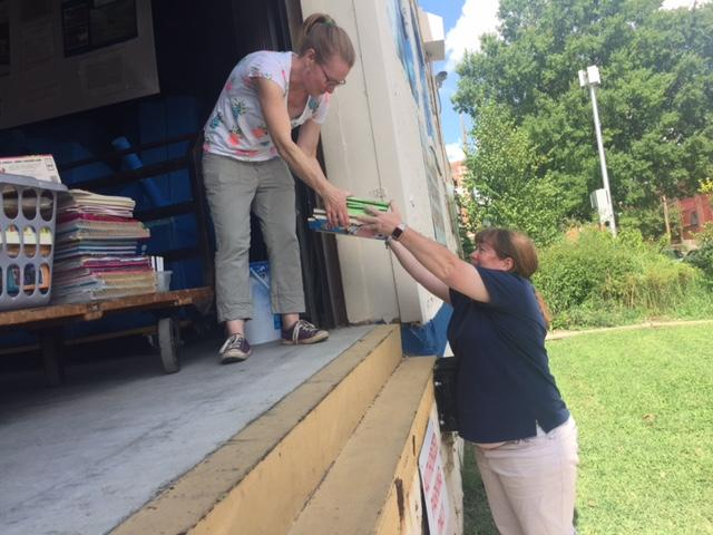 Kathleen Williams takes teaching supplies from Cecilia Wright. Williams is a co-founder of the Teacher Supply Swap and Wright is a regular there. She often gets supplies from other teachers at her school, St. Casimir Catholic School, for big drop offs.