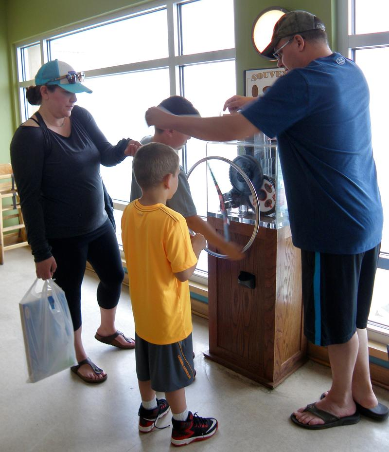 The Matson family, on their way home to New Hampshire, plays with the penny press machine