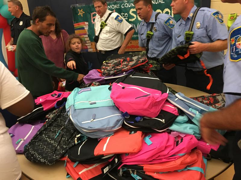 Bookbag giveaway at Sollers Point Multi Purpose Center in Dundalk