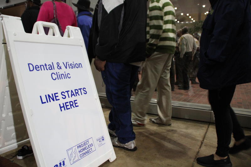 Baltimore residents wait in line outside the convention center for free dental and vision work
