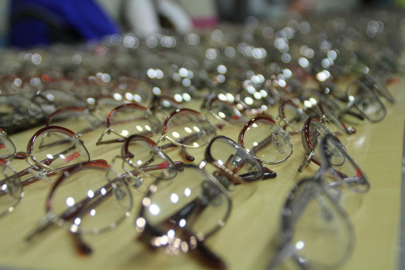 Donated glasses are laid out for people to receive new perscriptions on-the-spot.