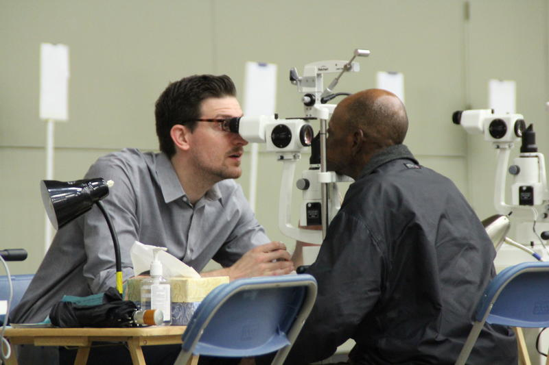 One resident has his eyes examine by a doctor.