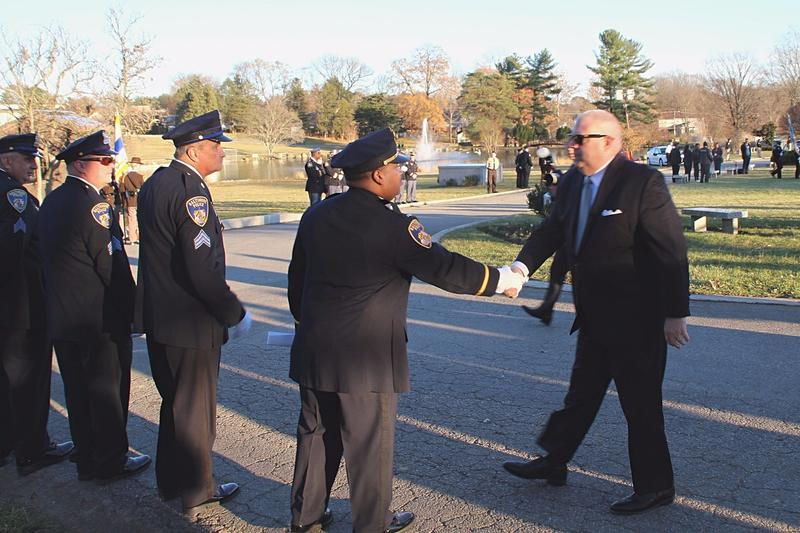 Maryland Governor Larry Hogan arrives at Dulaney Valley Memorial Gardens to bid farewell to Suiter.