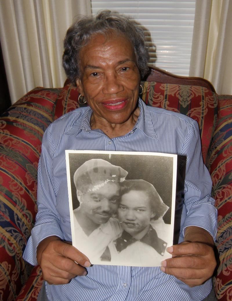 Catherine Veney Bundy, with a picture of herself and her husband, Thomas, who drowned while oystering on the Rappahannock River in December 1953
