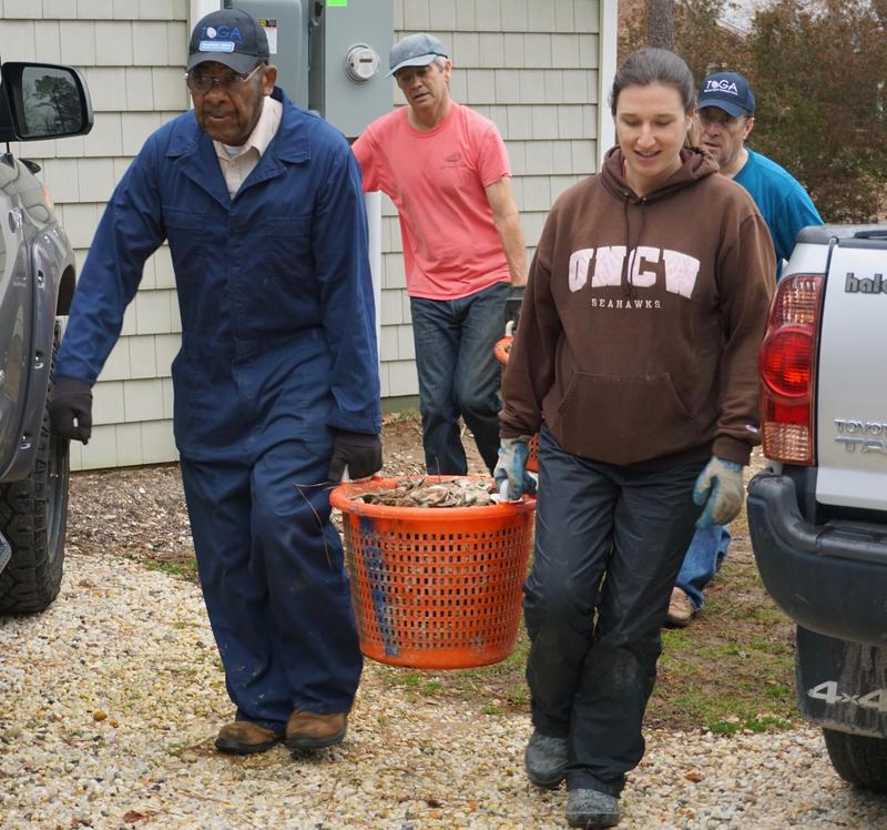 TOGA's Madison Boyd and CBF's Jackie Shannon haul off one bushel of shells