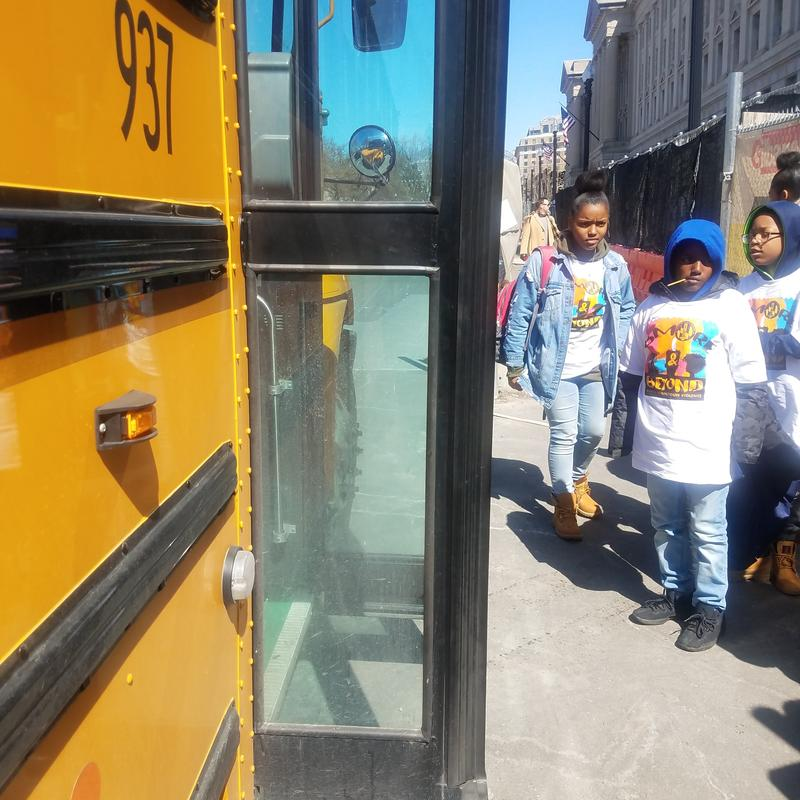Students getting off the bus in Washington