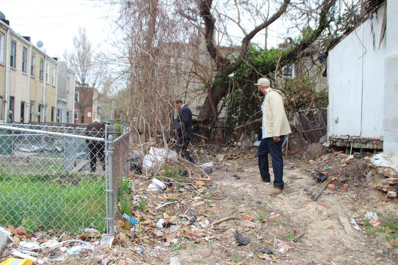"Marvin Hayes, a 32-year-resident of the Penn/North neighborhood stands in ""The Hole"" an alleyway on North Stockton Street. Hayes says that illegal dumping and boarded up homes has created an abundance of open-market drug dealing."