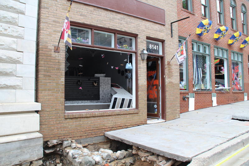 A DIVAZ Boutique on Main Street with sink hole infront.