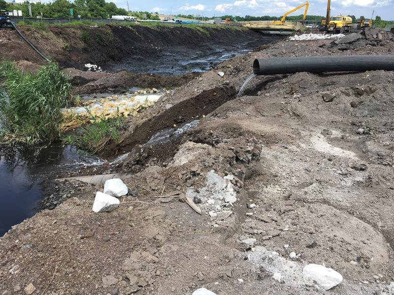 Water pumped around cleanup site and pouring into the canal downstream