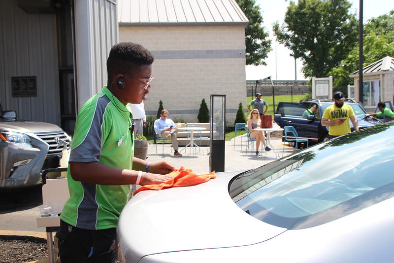 Kai Anderson, 15, has a permanent job with Canton Car Wash as the school year begins.