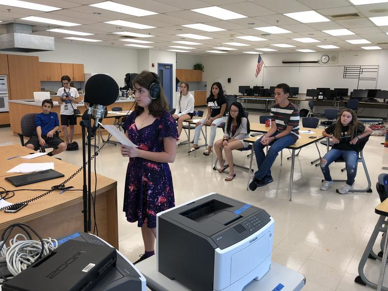 A Marjory Stoneman Douglas High School sophomore records a verse she wrote during a songwriting workshop following a session of Camp Shine.