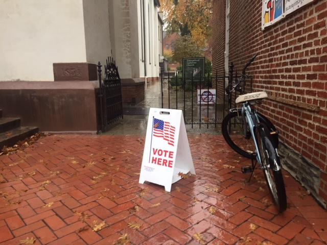 A sign at Evangelical Lutheran Church in Frederick points voters in the right direction