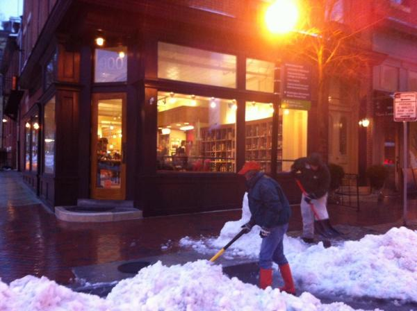 Vicki Schassler shoveled the sidewalk in front of Spirits of Mount Vernon in Baltimore.