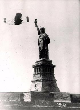 Wilbur flies around the Statue of Liberty