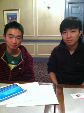 Left to right: Jia'nan Zhang and Kun Li at the Chinese American Culture Association Thanksgiving dinner