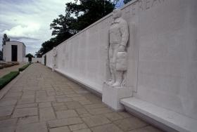 At the American Cemetery, a wall of 10,000 names, airmen who were never found