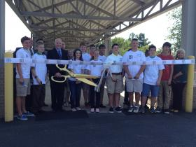 Students participate in the ribbon cutting ceremony at Springfield's Global Impact Stem Academy.