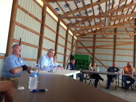 U.S. Sen. Portman (center) spoke with farmers at Mike Farm Enterprises near Centerville Wednesday. Owner Mike Clark is on the left.