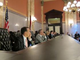 Members of the Ohio controlling board prior to the Medicaid expansion vote. From front to back, Rep. Chris Redfern (D-Port Clinton), Rep. Jeff McClain (R-Upper Sandusky), Controlling Board Secretary Anne Dean, Controlling Board President Randy Cole, and Sen. Bill Coley (R-Cincinnati).