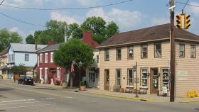 Buildings on the eastern side of Main Street near the Miami Street intersection in Waynesville, Ohio, United States. This block is part of the Waynesville Main Street Historic District, a historic district that is listed on the National Register of Historic Places.
