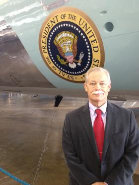 Historian, Dr. Jeff Underwood Stands Before Air Force One.