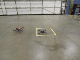 Two quadcopter drones take an indoor spin at SelectTech Geospatial in Springfield.
