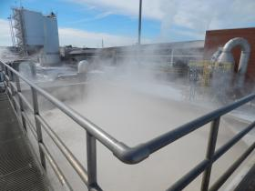 The first stop at the lime recycling plant is a bubbling brown vat where lime sludge is re-carbonated. blue lake