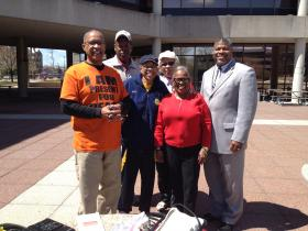 NAACP members pose with Springfield residents at a gun violence forum Wednesday.
