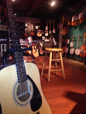 Before: Musical instruments adorn the floors and walls of Hauer Music in March.