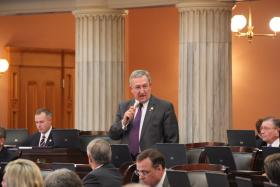 Rep. Blair speaks on the House floor during session (2013).