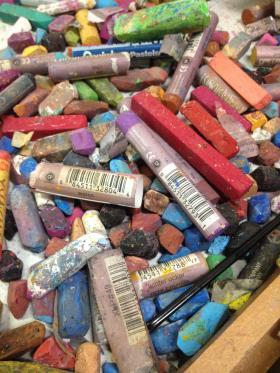 Oil pastels in Bing's West Third Street studio at the Ebonia Gallery.
