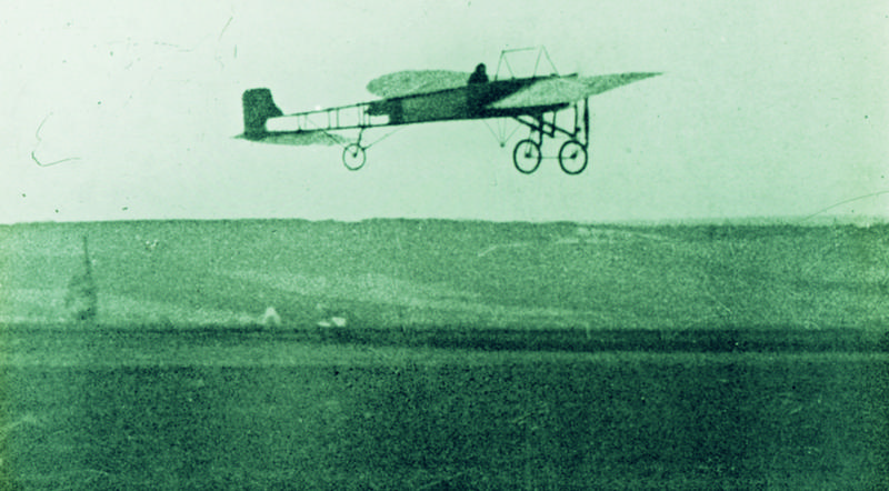 A photo of the actual flight, Louis Bleriot crossing the English Channel.