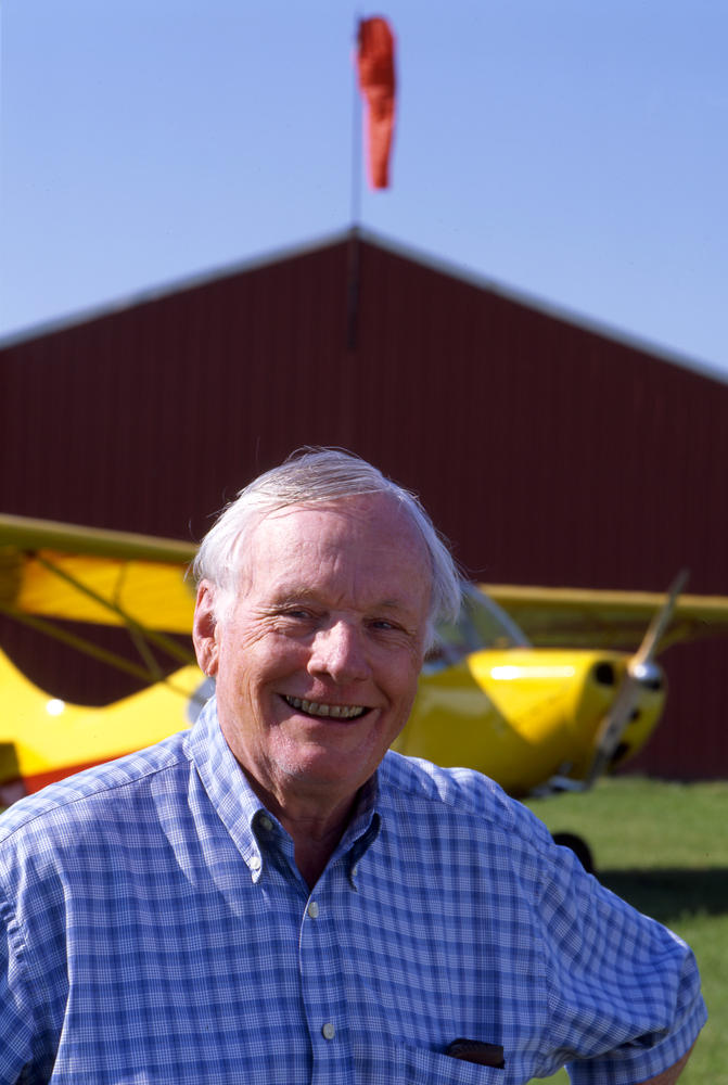 Neil Armstrong posing in front of a restored Aeronca Champ in 2003.