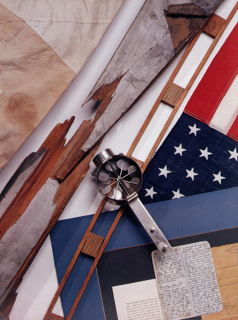 Top left fabric from the first flight in 1903, diagonally the broken propeller from the 17 September, 1908 crash, the flag given to Orville by the Commander of Ft. Myer in 1908, center, an anemometer used by the Wrights.