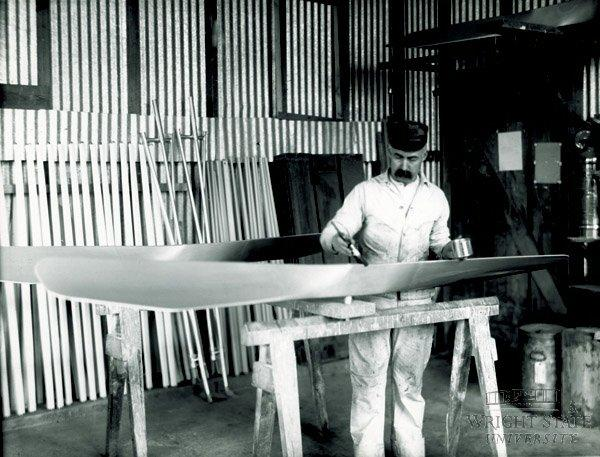 Harry Harold painting a propeller in the Wright Company factory in 1911..
