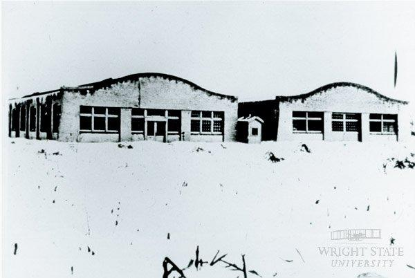 Exterior view of the Wright Company factory surrounded by snow in 1911