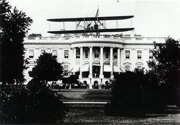 Harry Atwood landing a Wright Flyer on the White House lawn in 1911.